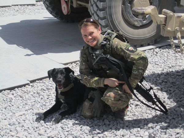 Pam Alley in Afghanistan with service dog Riley