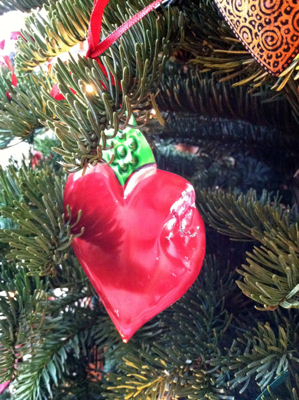 Tin heart ornament with teeth marks